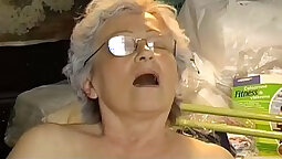 Chubby granny masturbates herself