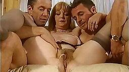 Horny mature hottie pisses in both holes