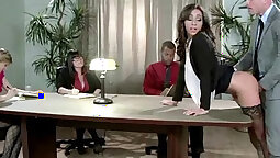 Busty office slut takes to the ring
