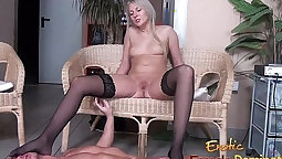 blonde gives a foot job to a dude in her turn room