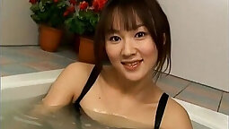 Amazing Japanese model Megumi show off her boobs