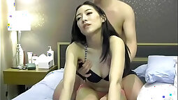 College couple get ready for a boy banging on the couch