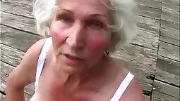 Cute fellow teasing dark grandma